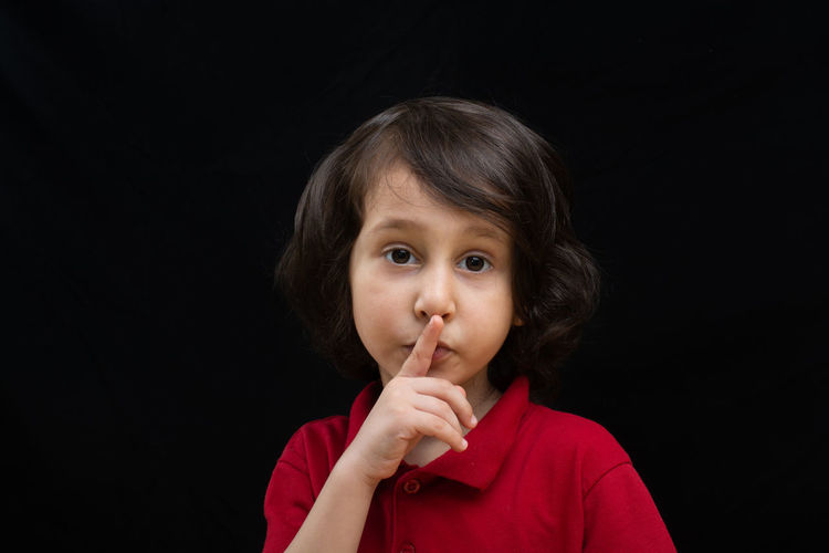 Adorable Advertising Boy Caucasian Cconcept Child Communicate Cute Emotions Expression Face Finger Gesture Hush  Indoors  Innocence Isolated Keep  Kid Lifestyle Lip Lips Lovely Male Mouth Mute Pose Preschool Quiet Secrecy Secret Shh Shush Shut Sibling Silence Silent Whispering Worried Zipped