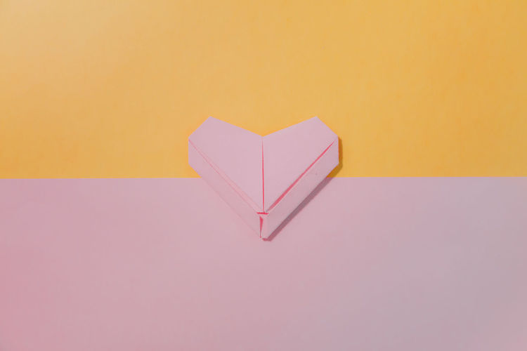 Pink paper heart on pastel background. Paper Heart Shape Indoors  Art And Craft Love Studio Shot Positive Emotion No People Copy Space Still Life Pink Color Close-up Heart Origami Valentine Minimalism Minimal Pastel Abstract Textured  Art Pattern Wallpaper Love Decoration Cute Romantic Shape Design Card Celebration Love ♥ Yellow Pastel Colored