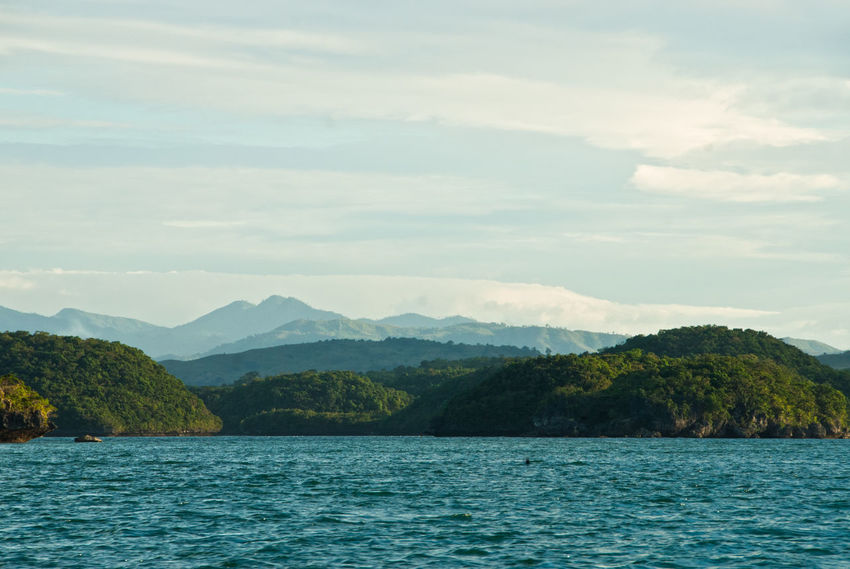 Hundred Islands  Beauty In Nature Cloud - Sky Day Landscape Mountain Mountain Range Nature No People Outdoors Pangasinan Scenics Sea Sky Tranquil Scene Tranquility Tree View Into Land Water Waterfront