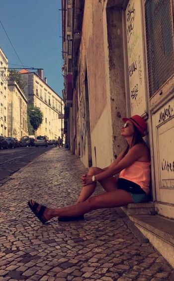 AllAboutTravelling💚 Me Street Of Lisbon Portugal Lisboa Lisbon One Person Architecture Adult Women Real People Full Length Lifestyles Young Women Shoe Sitting Day Built Structure City