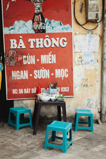 ASIA Eating Stool Vietnam Vietnamese Vietnamese Food Architecture Cafe Chair Day Eat Food No People Outdoors Restaurant Southeast Asia Street Street Photography Streetphotography Table Text
