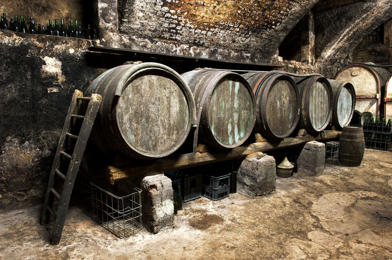 nterior of an old wine cellar Beverage Casks Old-fashioned Aging Barrel Business Cellar Container Cylinder Distillation Drink Fermentation Food And Drink Industry Grapes Maturing Oak Old Viticulture Wine Cask Wine Cellar Winemaking Winery Winery View