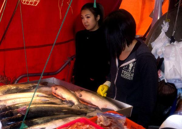 Selling fish at Steveston fisherman's wharf. Richmond BC Steveston Village Selling Fish Steveston Young Women Women