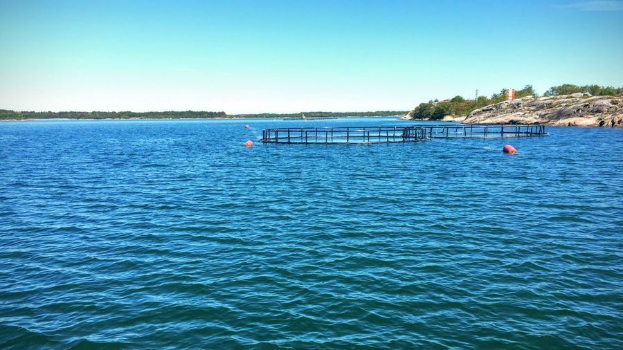 the sea around Aland Aland Islands Bridge Bridge - Man Made Structure Connection Distant Fotostrasse Jetty Lake Outdoors Pier Railing Reflection Rippled River Sea Tranquil Scene Tropical Climate Vacation Vacations Visit Ala Water Waterfront Wooden Post