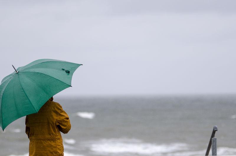 Close-Up Of Person Holding Umbrella