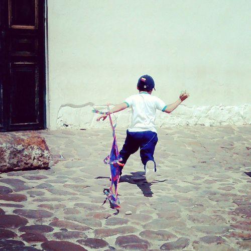 Kite runners Children Childrentoy Kites Wind running cobblestones