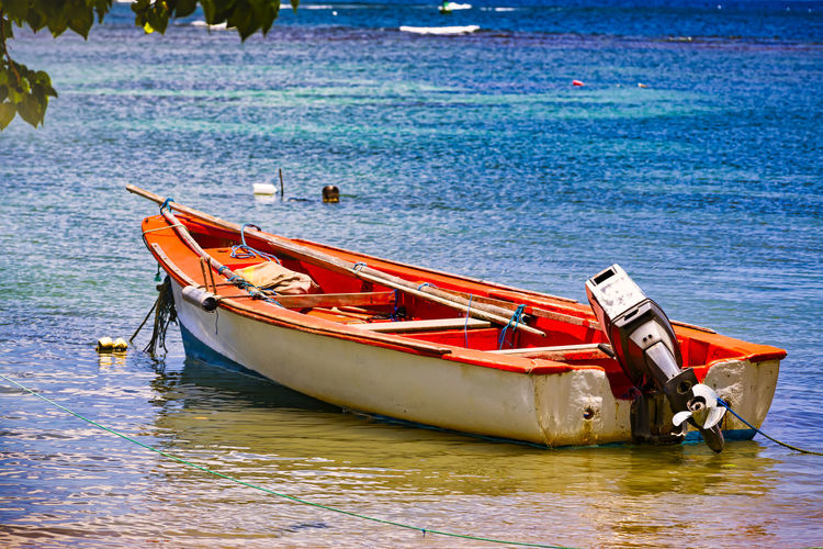 Boat moored on sea