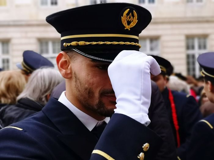 Close-up of sailor in military uniform standing on street