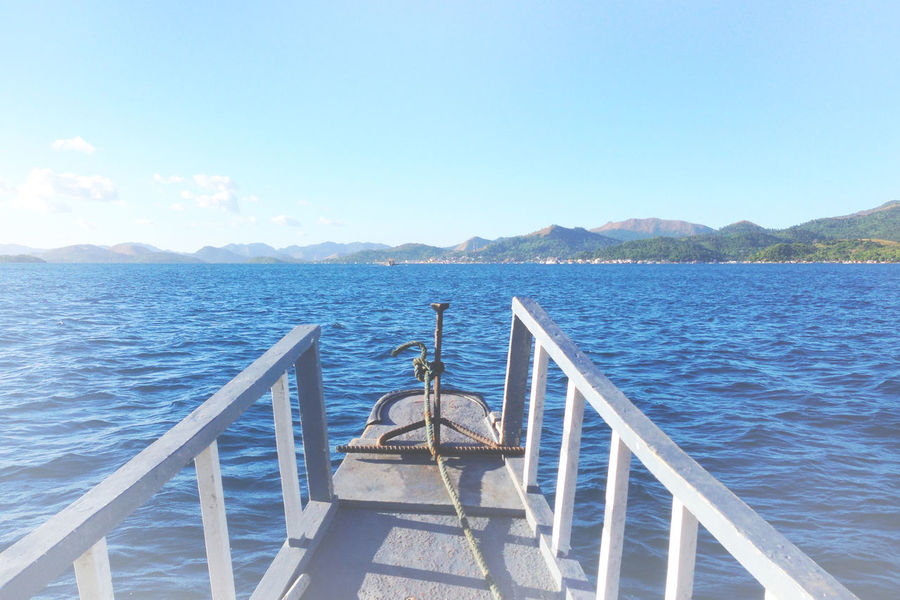 the beauty of Coron Philippines Travel Wanderlust Adventure Beauty In Nature Blue Boat Boat Ride Clear Sky Coron Day Explore Itsmorefuninthephilippines Mountain Nature No People Outdoors Palawan Scenics Sea Sky Tranquil Scene Tranquility Travel Destinations Water