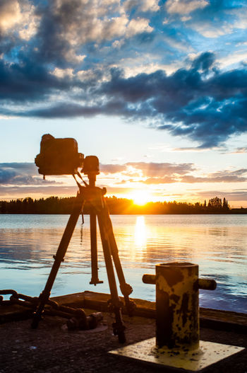 Taking memories Architecture Beach Camera Camera - Photographic Equipment Chain City Cloud - Sky Day Forest Lake Long Exposure Nature No People Outdoors Paint The Town Yellow Pier Sea Sky Sky And Clouds Sunrise Sunset Tripod Tripods Twilight Water