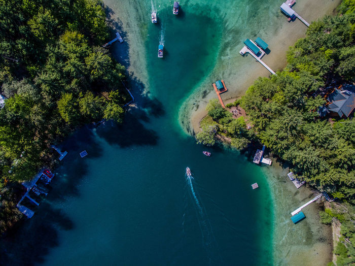 Aerial View Beauty In Nature Blue Boat Boating Canal Day Drone  Dronephotography Elevated View High Angle View Nature River Riverside Scenics Sea Tranquil Scene Travel Tree Vacations Water Waterfall