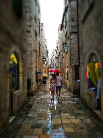 raining in Dubrovnik Photowalktheworld City Bicycle Full Length Cityscape Men Wet Cycling Architecture Built Structure Building Exterior Alley Puddle Muddy vanishing point Narrow The Way Forward Mud Diminishing Perspective Long Pathway Monsoon Rainy Season Empty Road