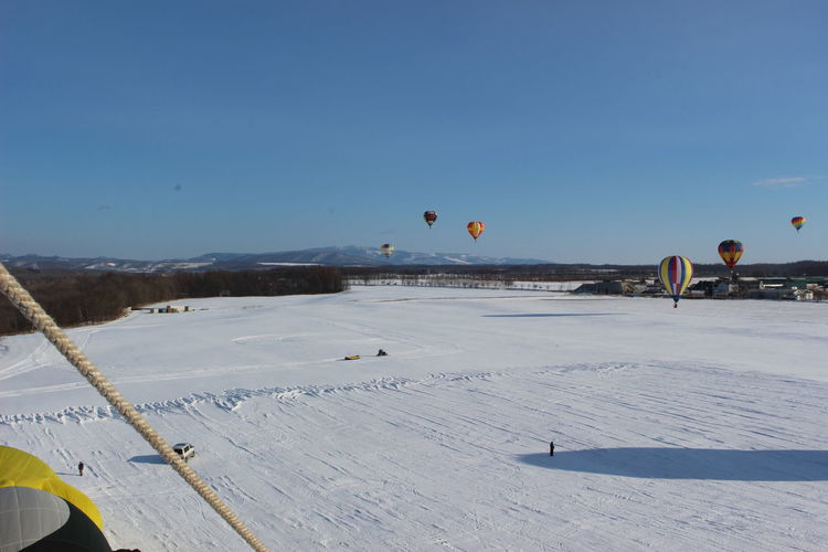 Scenic view of hot air balloon against sky