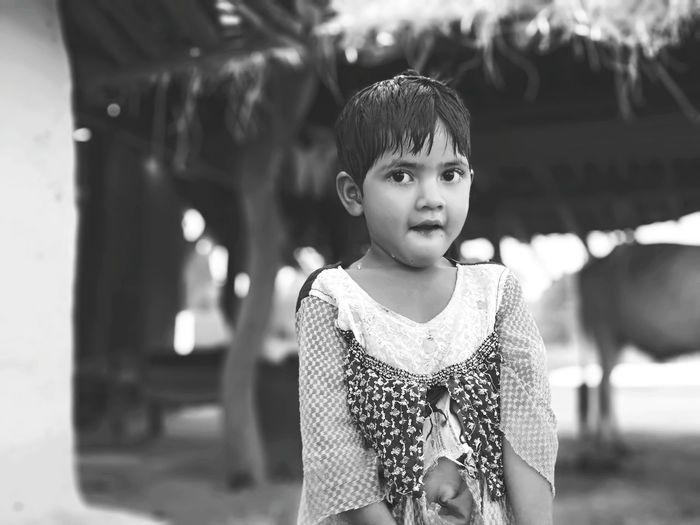 Portrait Of Wet Girl Standing Outdoors