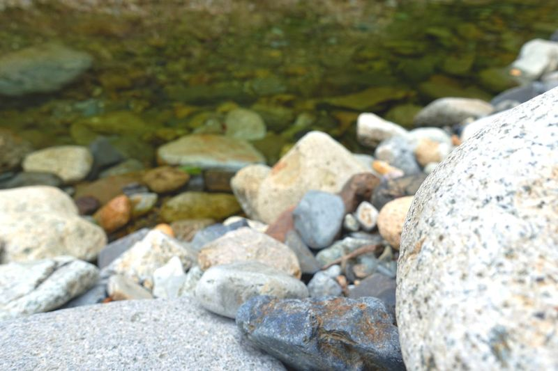 Close-up of stones in water