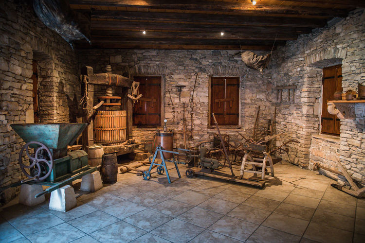WINE MAKING TOOLS OF YESTER-YEAR Croatia, Sibenik ❤ Hopper, Korcula Island Old Wine Skins Old Stone Building Timber Roof, Wine Press Antique Architecture Ceiling Timber Beams, Flag Stone Floor History Indoors  Large Group Of Objects No People Stone Windows The Past