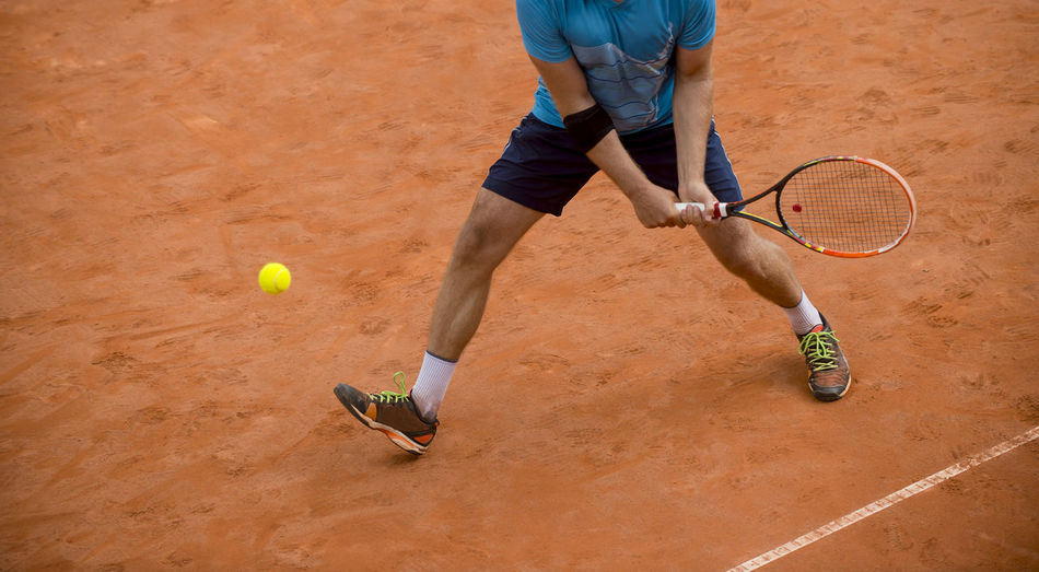 Low Section Of Player Playing Tennis