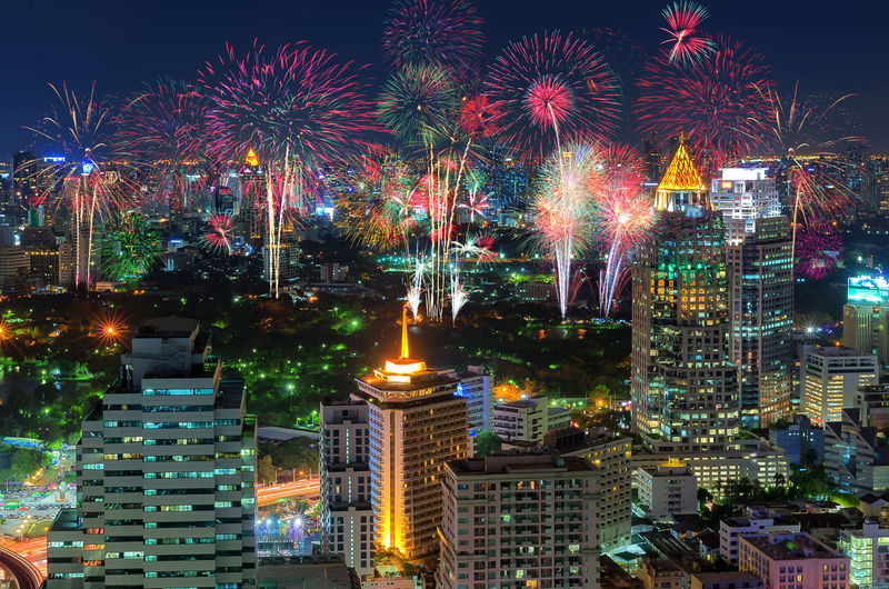 Fireworks celebration In the business district of Bangkok nightlife. Bangkok Thailand New Year Night City Firework ASIA Cityscape Fireworks Sky Festival View Christmas Landscape Eve Blue Happy Party Light Water Holiday Downtown Thai Colorful Architecture Building Celebration Town Countdown Event Beautiful Celebrate