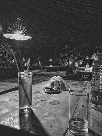 Fusion Restaurant, Vagator. Cushioned Floor Eatery Vagator Goa India Restaurant Table Drink Lanterns Lights Blackandwhite B&w Eyemphotography Eyem Best Shots EyeEm Best Shots EyeEm Gallery EyeEm Selects EyeEmBestPics Table Night Outdoors No People Water Drink Close-up Nature Sky