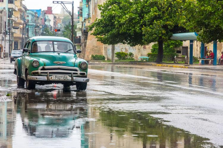 Architecture City City Life Cuba Extreme Weather Havana Outdoors Rainy Season Reflection Street Street Photography Streetphotography Taxi Transportation Urban Urban Exploration Urban Lifestyle Urbanphotography Wet