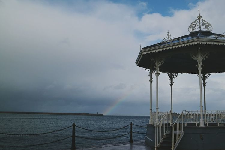 Sky Cloud - Sky Outdoors Sea Water Day Hanging Out Taking Photos Seaside Built Structure Rainy Days Rainbow