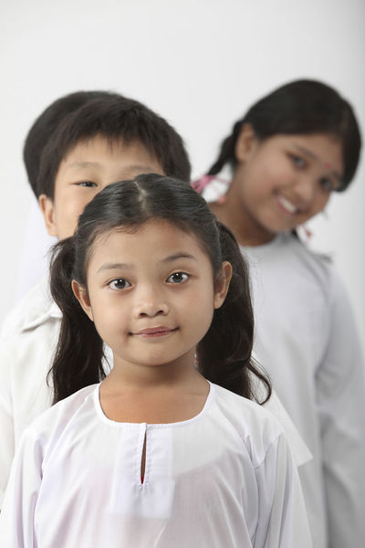 group of malaysia primary student with school uniform Happiness In A Row Indian Innocence Kids Patriotism Student Uniform Back To School Chinese Elementary Age Group Of People Harmony Malay Malaysia Mixed Race Multiracial  Portrait Primary Students School Uniform Smiling Studio Shot United White Background ın A Row