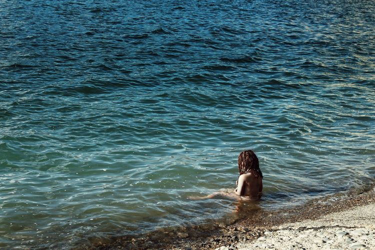 Full length of woman in sea