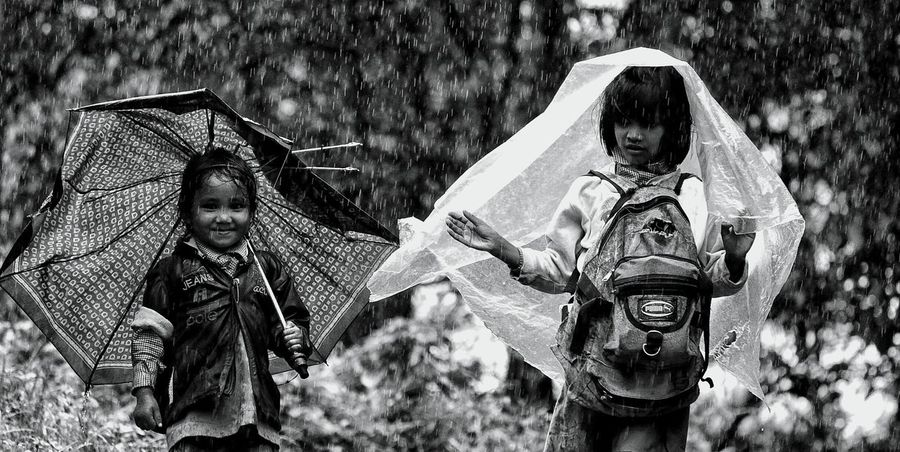 The joy of having a sister... something i never experienced.. but i guess i feel nowFriendship Togetherness Real People Childhood Outdoors Rain After School ✏ Rural Scene The Week On EyeEm EyeEmNewHere