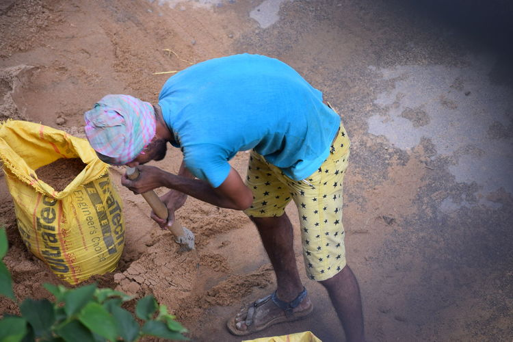Man in work One Person High Angle View Sand Adults Only Adult Full Length People Only Women Outdoors Young Adult Day Dailystruggle