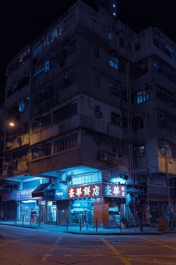 Kowloon City 九龍城 Cake Shop One Person Cyberpunk Bladerunner Moodygrams EyeEm Best Shots EyeEm Selects Building Exterior Night Architecture Built Structure Illuminated City Street Transportation Road Building No People Outdoors Sign Mode Of Transportation Sky Residential District City Street Communication Direction City Life The Street Photographer - 2019 EyeEm Awards