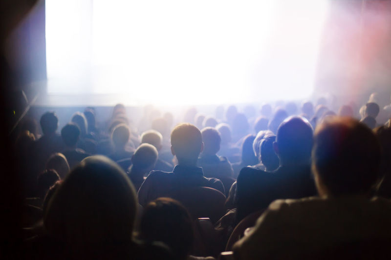 people at the theater Watching Light Spectator Stage Lighting Equipment Illuminated Arts Culture And Entertainment Group Of People Crowd Audience Performance Event Music Enjoyment Nightlife Festival Fun Stage Light Theater Play Sitting Back Unrecognizable Space Rows