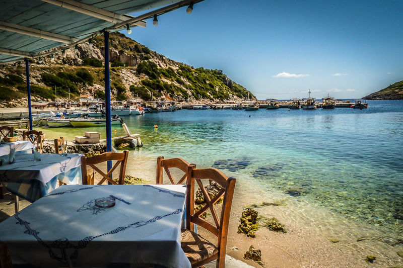 Taverna By The Sea La Storia at Agios Nikolias in the north of Zakynthos island Greece Agios Nikolaos St Nicholas St Nicholas Port Chairs Greece Greek Islands Holiday Ionian Island Sea Seaview Shore Summer Table Taverna Tourism Travel Vacations Vacations Water Zakynthos Zante Coastline
