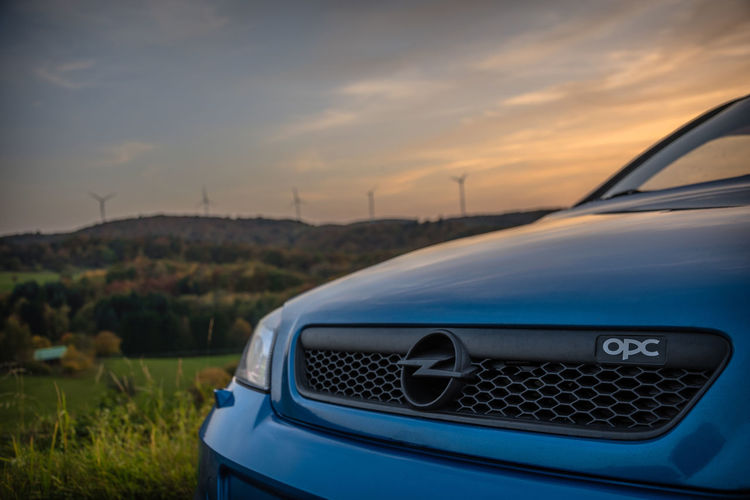 OPC. Cars Carspotting Nature Photography OPC Opel Pinwheel Sunlight Car Cloud - Sky Landscape Mode Of Transportation Natur Nature No People Opel Astra Opel Astra G Sky Sun Sun Goes Down Sunset Windrad