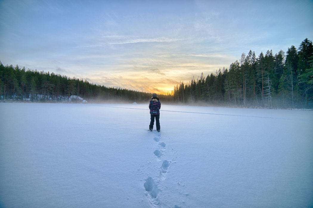 Girl looking for sunset at frozen lake. Adventure Beauty In Nature Cold Temperature Evening Evening Sun Frozen Ice Landscape Leisure Activity Lifestyles Nature One Person Outdoors People Real People Scenics Sky Snow Sunset #sun #clouds #skylovers #sky #nature #beautifulinnature #naturalbeauty #photography #landscape Tree Warm Clothing Winter