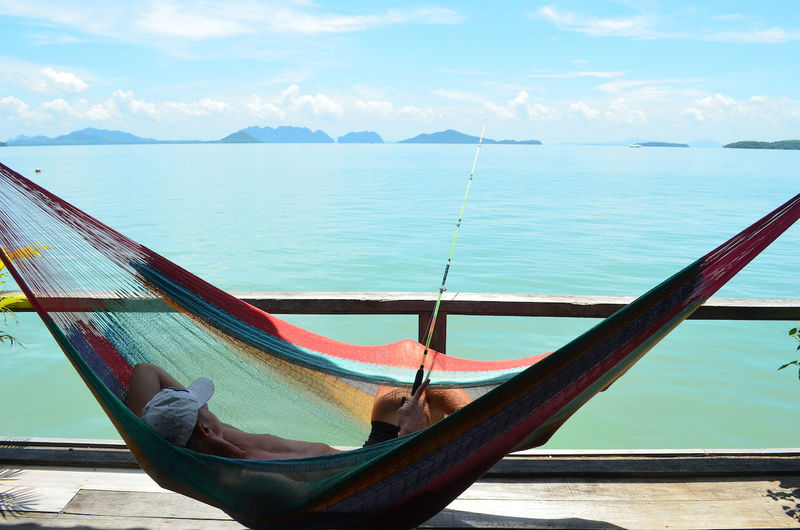 Beauty In Nature Blue Cloud Cloud - Sky Day Fishing Hammock Hammock Time Idyllic Mountain Nature Ocean Outdoors Scenics Sea Sky Tourism Tranquil Scene Tranquility Travel Destinations Vacations Water