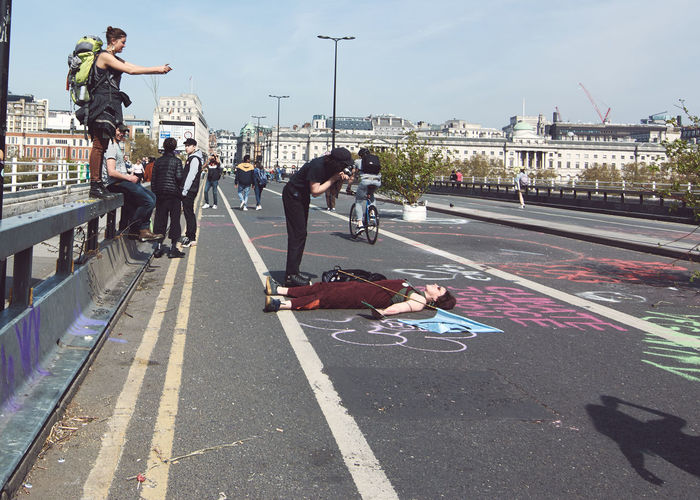 Extinction Rebellion - London 2019 Extinction Rebellion Protest Protesters London City Street Group Of People Real People Transportation Road Architecture Sign Lifestyles Men Day Building Exterior Marking Full Length Nature People Sky Road Marking Symbol Built Structure Outdoors