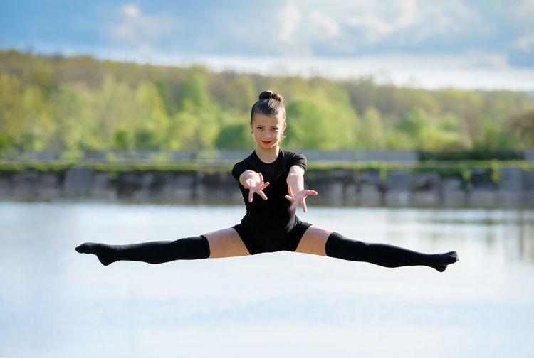 Athlete Balance Caucasian Female Flexible Gymnast  Gymnastics Horizontal Jump Leap Leg-split Rhythmic Split Sport Stretch Warm-up Woman Workout Young