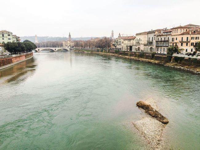 Verona, con le sue vecchie mura che l'attorniano, i suoi ponti dai parapetti merlati, le sue lunghe e larghe vie, i suoi ricordi del Medioevo, ha una grande aria che incute rispetto. Nofilter Clouds And Sky Picoftheday River City Mycity Love