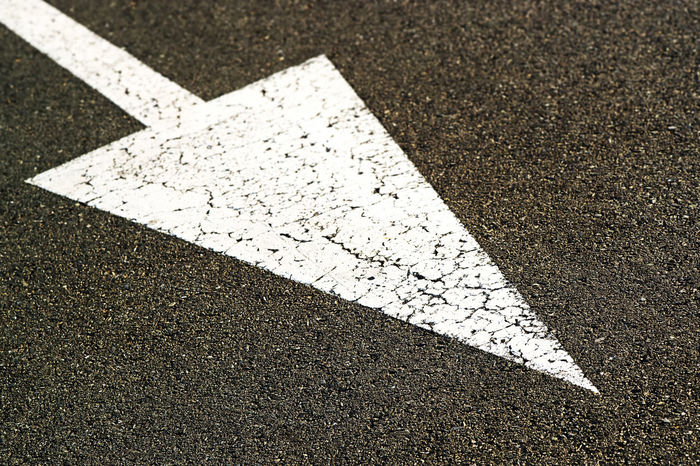 arrow road sign in highway asphalt Arrow Arrow Sign Arrow Symbol Asphalt Background Backgrounds Concept Conceptual Destination Destiny Direction Guidance Highway My Way No People Obligatory One Way Outdoors Road Road Marking Road Sign Street Way