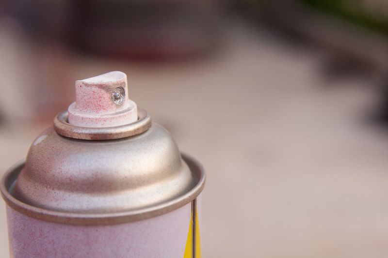 close up head aluminum spray paint can. with copy space Colors Gas Graffiti Hairspray Aerosol Can Art And Craft Bottle Carbon Chemical Close-up Copy Space Craft Day Design Dirty Flat Metal Metallic Rusty Selective Focus Single Single Object Spray Spray Paint Tool
