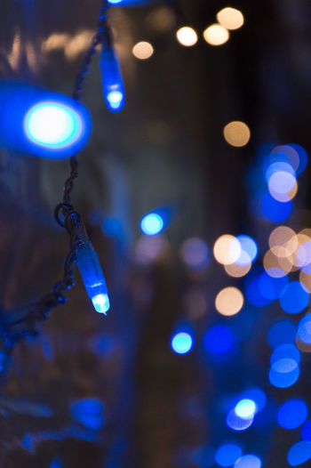 Arts Culture And Entertainment Blue Bokeh Bubble Circle Close-up Depth Of Field Detail Drop Focus On Foreground Glass Glowing Ideas Illuminated Indoors  Light Light Multi Colored Music Night Rain Selective Focus Shiny Transparent Wet HUAWEI Photo Award: After Dark