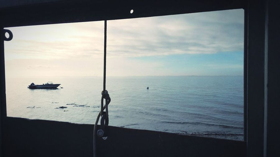 Beach Scenics Outdoors Nature Naturelover Landscape Tranquility Beauty In Nature Water Windless Boats And Water Boat Window View Window Frame Frame It! Minimalism Contrast The Great Outdoors - 2017 EyeEm Awards