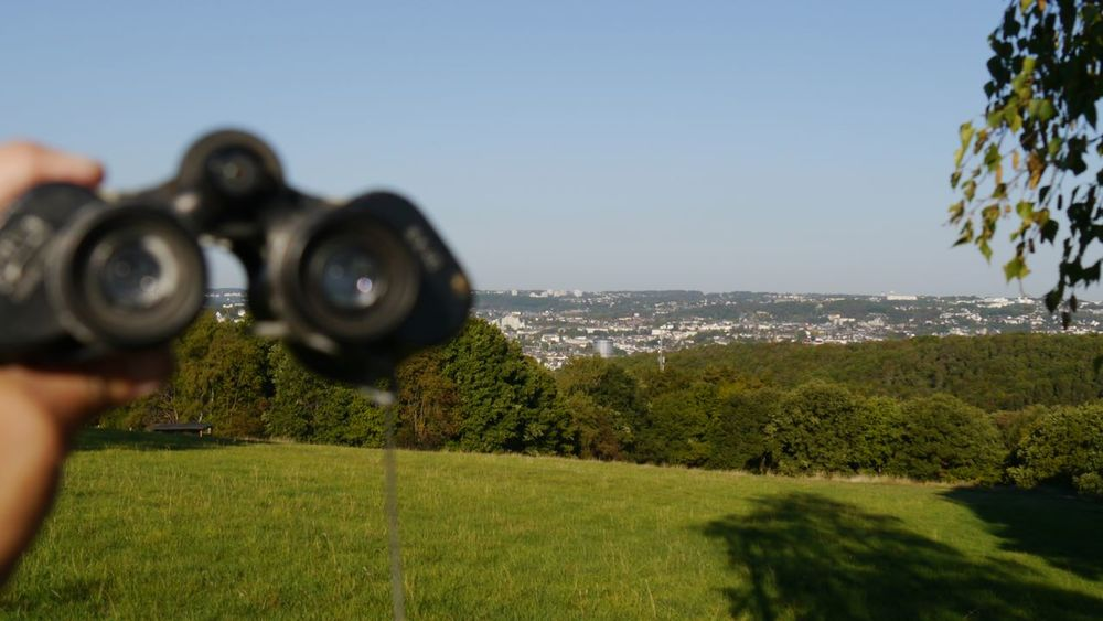 landscape of Wuppertal- view through field glasses Binoculars Binocular View Hand Holding Binoculars Landscape Countryside Nature Landscapes Countryside Landscape Forest Trees cityscapes Grassland Focus On Background Water Sea Clear Sky Photography Themes Beach Tree Men Sky Horizon Over Water Grass Binoculars Observation Point Hand-held Telescope