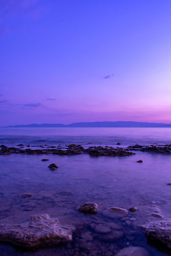 EyeEm Nature Lover EyeEmNewHere HUAWEI Photo Award: After Dark Beach Beauty In Nature Cloud - Sky Dusk Eyem Best Shots Land Motion Nature No People Purple Rock Rock - Object Scenics - Nature Sea Sky Solid Sunset Tranquil Scene Tranquility Twilight Water