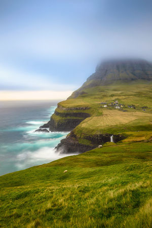 Gásadalur waterfall in Faroe Islands. Atlantic Cliff Dreamy Faroe Islands Gasadalur Grass Green Green Color Island Long Exposure Mountain No People Norwegian Sea Ocean Sea Sheep Sky Tranquil Scene Tranquility Vagar Vilage Water Waterfall