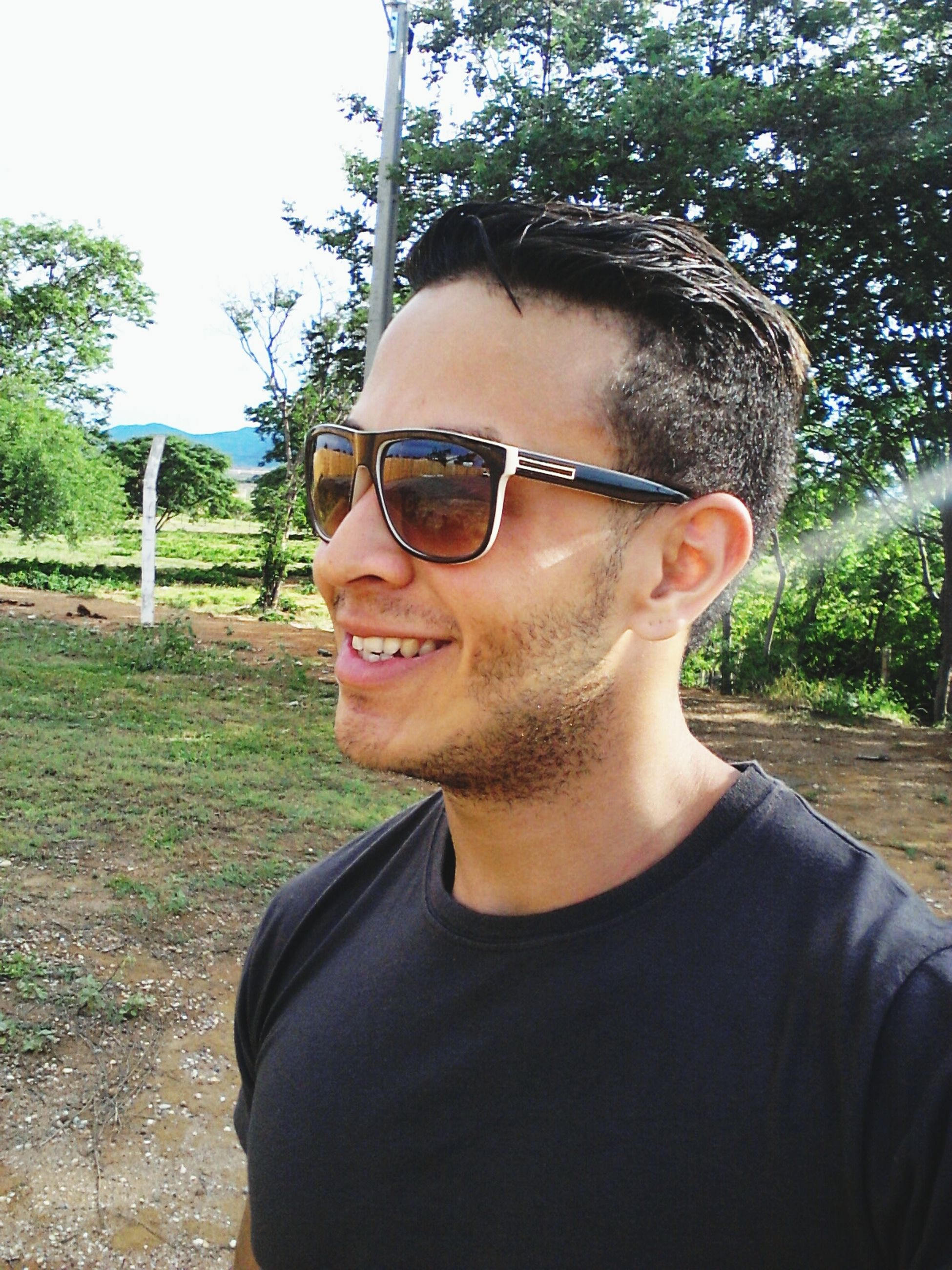 portrait, looking at camera, young adult, person, lifestyles, young men, front view, sunglasses, leisure activity, headshot, casual clothing, smiling, mid adult, mid adult men, head and shoulders, handsome, happiness, serious