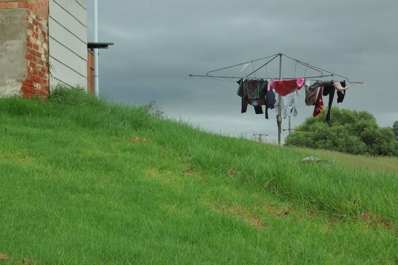 Hills Hoist Clothesline Hang Out To Dry Grass Moody Hung Out Hung Out To Dry Washing Washing Line Back Yard Outside Gloomy Day Gloomy Weather Gloomy Washed Daily Life Everyday Life Ordinary  Laundry Laundryday Laundry Line Unmowed Lawn Long Grass Grey Skies Grey Sky