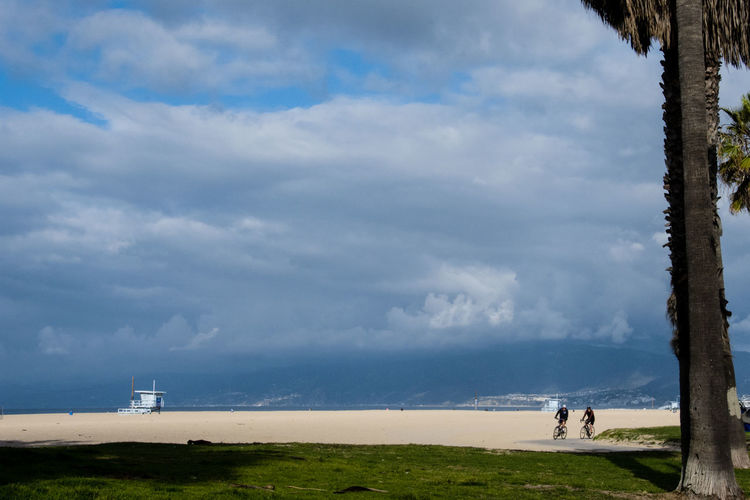 stormy weather Beach Beauty In Nature Cloud - Sky Day Field Grass Landscape Leisure Activity Lifestyles Men Nature One Person Outdoors People Real People Safeguard Scenics Sky Standing Windmill