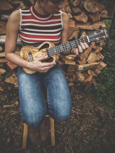 High angle view of woman playing guitar