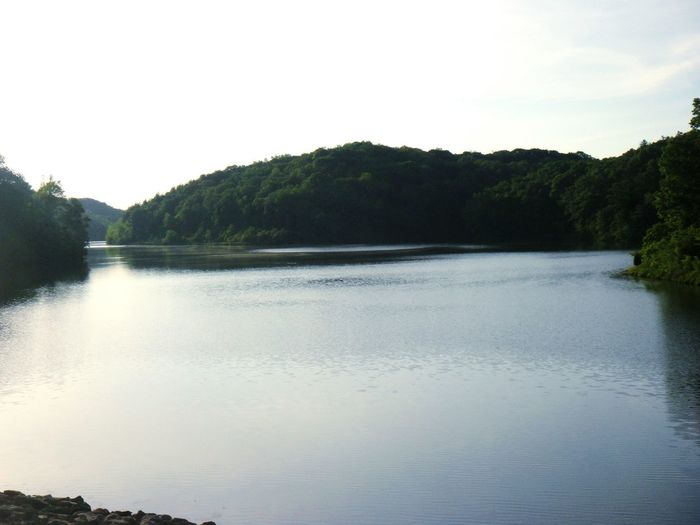 Calm lake with mountain in background